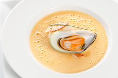 Carrot soup with seafood Stock Photos