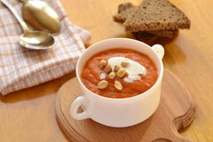 Carrot soup with sour cream Royalty Free Stock Photo