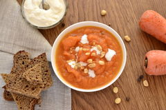 Carrot soup with sour cream Royalty Free Stock Photography
