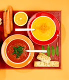 Carrot soup, tomato soup Royalty Free Stock Image