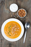Carrot Soup With Almonds And Yogurt On The Plate, Top View Royalty Free Stock Images