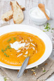Carrot Soup With Almonds, Yogurt And Watercress In A Plate Stock Photo