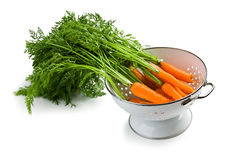 Carrot in strainer Royalty Free Stock Photo
