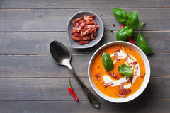 Carrot sweet pepper cream soup with bacon Royalty Free Stock Image