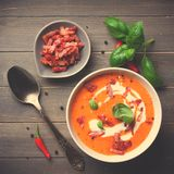 Carrot sweet pepper cream soup with bacon Royalty Free Stock Photography