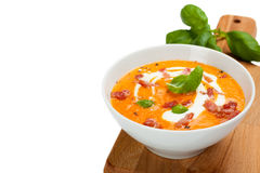 Carrot sweet pepper cream soup with bacon Royalty Free Stock Images