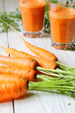Carrot on the table and two glasses of juice Stock Photo