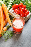 Carrot and tomato juice in glass Royalty Free Stock Image