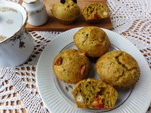 Carrot tomato muffins with wild plants. Cakes recipes, cooking healthy food stock images