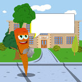 Carrot using a smartphone in front of a school with speech bubble Royalty Free Stock Photo