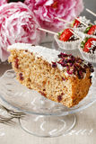 Carrot vegan cake with coconut icing and dried wild rose petals. (rosa rugosa stock photos