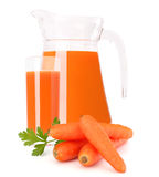 Carrot vegetable juice in glass jug. Isolated on white background cutout Stock Photos
