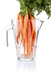 Carrot vegetable juice in glass jug. Isolated on white background cutout Royalty Free Stock Photos