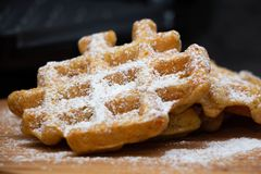 Carrot waffles with powdered sugar on a wooden board . Perfect healthy breakfast royalty free stock photos