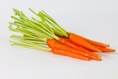 Carrot on the white table. Royalty Free Stock Images