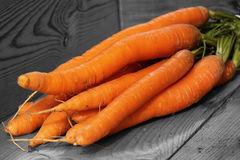 Carrot on wood selective color Royalty Free Stock Images