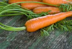 Carrot on wooden background Stock Images