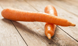 Carrot on wooden background Stock Photography