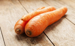 Carrot on wooden background Royalty Free Stock Photos