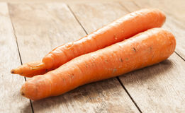 Carrot on wooden background Stock Image