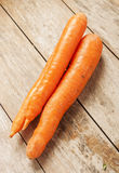 Carrot on wooden background Royalty Free Stock Images