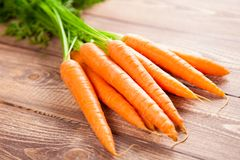Carrot on a wooden table Stock Images