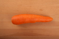 Carrot  on wooden table Royalty Free Stock Photos