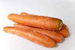 Carrots. Five carrots on white background Royalty Free Stock Photo
