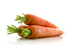 Carrots. Fresh carrots over white background Stock Photos