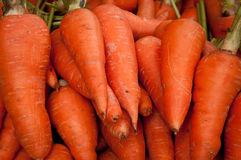 Carrots. Fresh carrots on an asian market stall royalty free stock photos