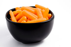 Carrots. A bowl of carrots on a white background Stock Image