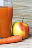 Carrots, apple and juice Royalty Free Stock Image