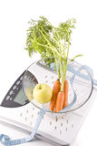 Carrots, apple and measuring objects Stock Photo