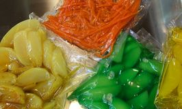 Carrots apples pears and other cooked vegetables are vacuum pack. Aged in special hermetic containers Stock Photography