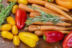 Carrots with basil, thyme, peppers Stock Photos