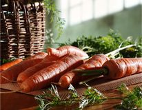 Carrots and basket in kitchen Royalty Free Stock Photos