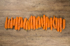 Carrots. Basket of carrots on wood stock photos