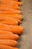 Carrots. Basket of carrots on wood Royalty Free Stock Images