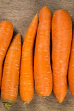 Carrots. Basket of carrots on wood Royalty Free Stock Photography