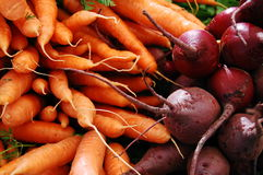 Carrots and beets. Freshly picked carrots and beets at a farmer's market in portland, oregon Stock Images