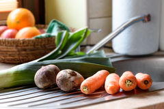 Carrots and beets. Fresh carrots and beets on the sink in the kitchen Royalty Free Stock Photo