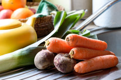 Carrots and beets. Fresh carrots and beets on the sink in the kitchen Royalty Free Stock Image