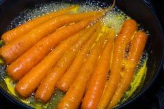 Carrots being glazed in orange juice. Royalty Free Stock Photo