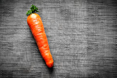 Carrots on black fabric background. Carrots on a black synthetic fabric background Royalty Free Stock Photography