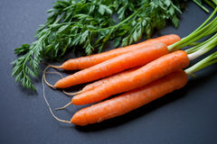 Carrots on a black table top Royalty Free Stock Photography