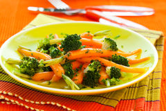 Carrots and broccoli Stock Photos