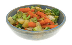 Carrots broccoli and cauliflower in an old stoneware bowl Royalty Free Stock Images