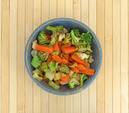 Carrots broccoli and cauliflower in an old stoneware bowl Royalty Free Stock Photography