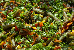 Carrots, broccoli, green beans, corn, fried in olive oil. And sprinkled with parsley Stock Images