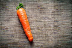 Carrots on brown fabric background. Carrots on a brown synthetic fabric background Royalty Free Stock Photo